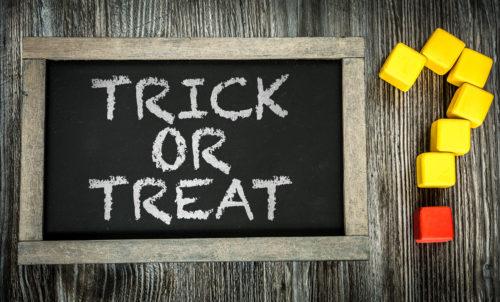 Trick or Treat? written on chalkboard